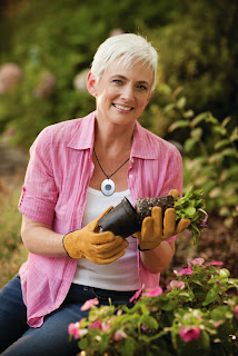 call button worn by elderly woman gardening