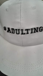 Hat with the hashtag adulting