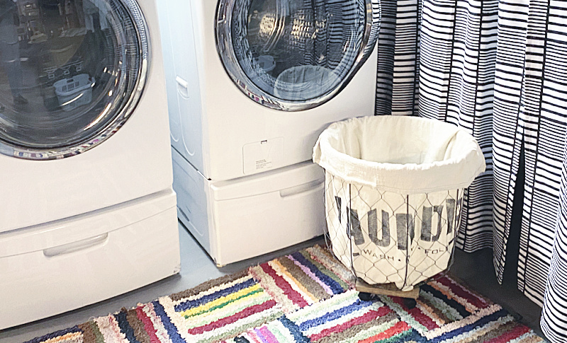 washer, dryer and stenciled laundry basket
