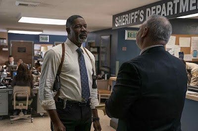 Movie still for Netflix's 2019 film Secret Obsession where Dennis Haysbert tries to find out what happened to Brenda Song as the detective on her case