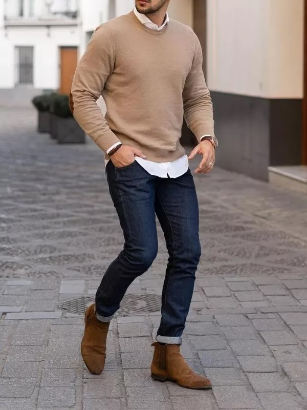 A man in sweater and jeans.