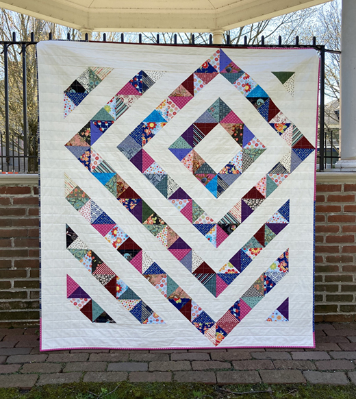 Scrappy Four Patch Charm Quilt by Deb Gehringer of Monday Morning Designs, The Pqttern designed by Kathy Schwartz Tamarack Shack Longarm Quilting Blog