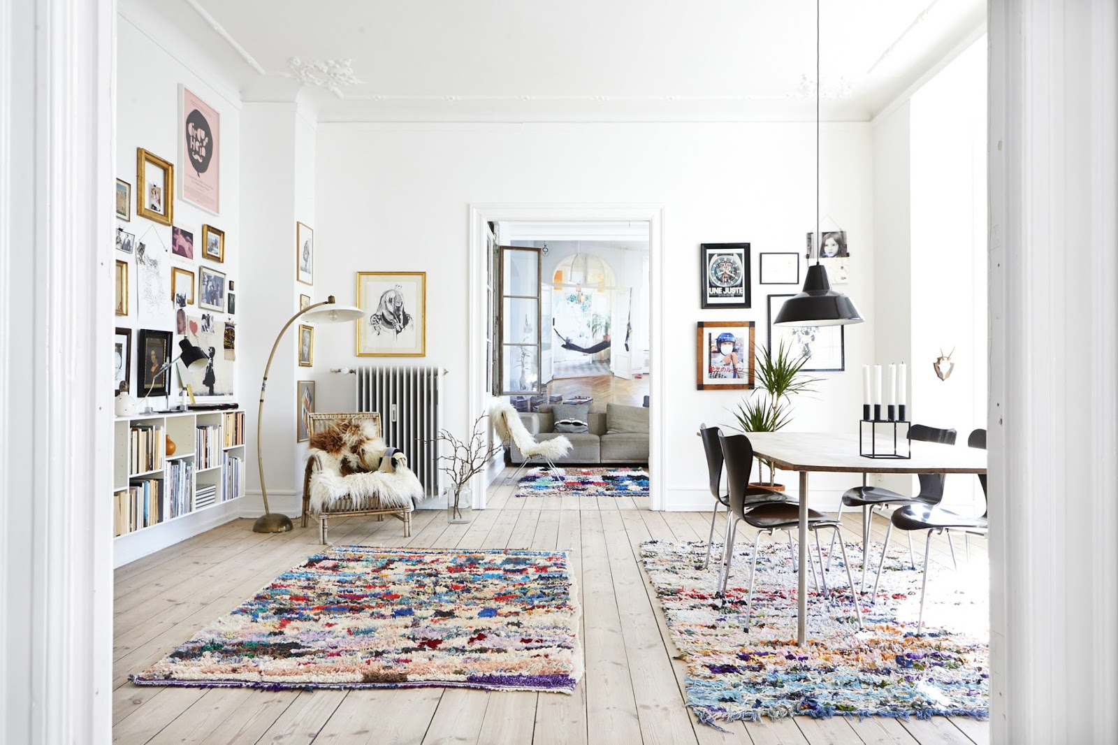 bohemian scandinavian apartment with moroccan rugs, wall art and design furniture