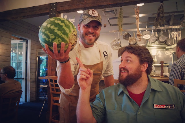 Chef David picked watermelon from the front yard of the restaurant for a snack and a cocktail!