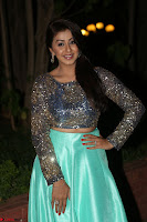 Nikki Galrani in Green Skirt  Top at Marakathamani music launch ~  Exclusive (21).JPG