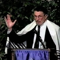 Leonard Nimoy wearing a tallit (prayer shawl) and showing the Vulcan salute