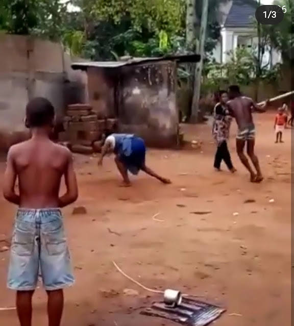 Watch the Moment a Man flogged and Kicked an Elderly Woman in Anambra (video)