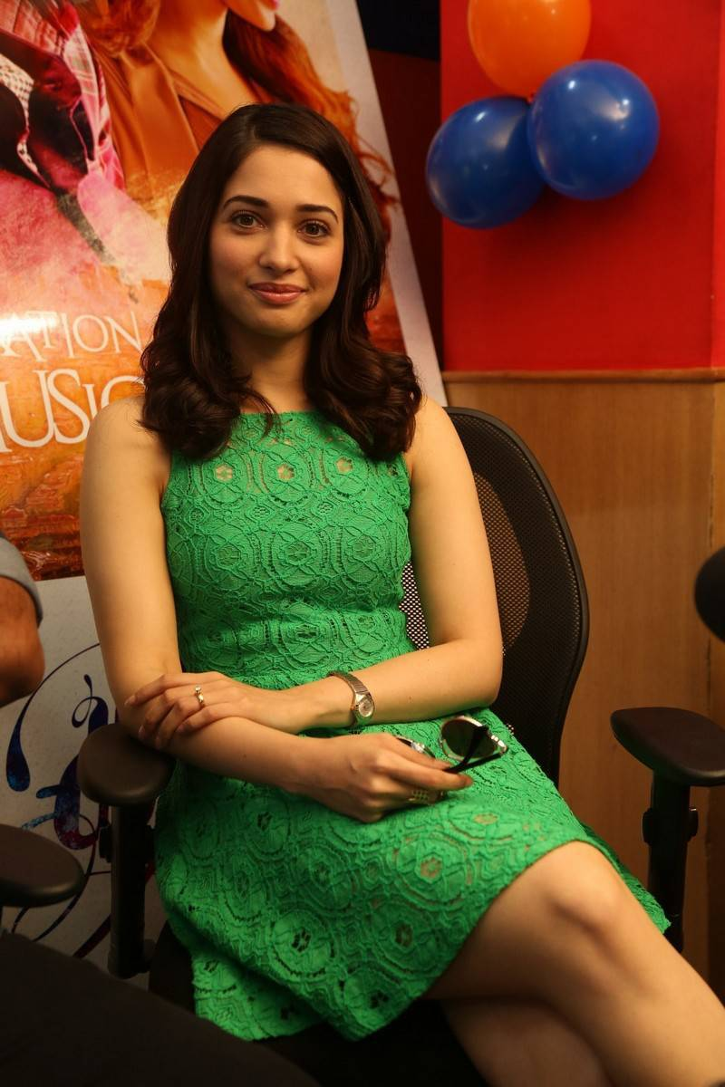 Actress Tamanna Legs Show Photos In Green Dress