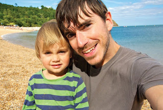 Anya's husband Simon clicking selfie with their son