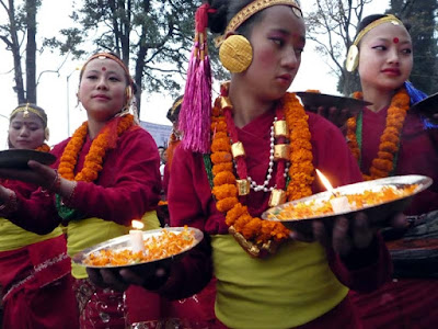 Nepali girls with traditional attire dancing at tourism festival
