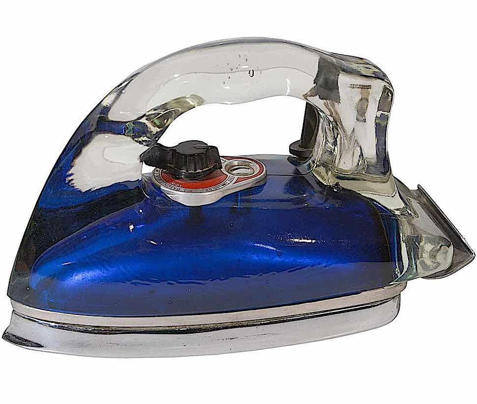 a 1940s Silver Streak Pyrex glass laundry iron in a color photograph