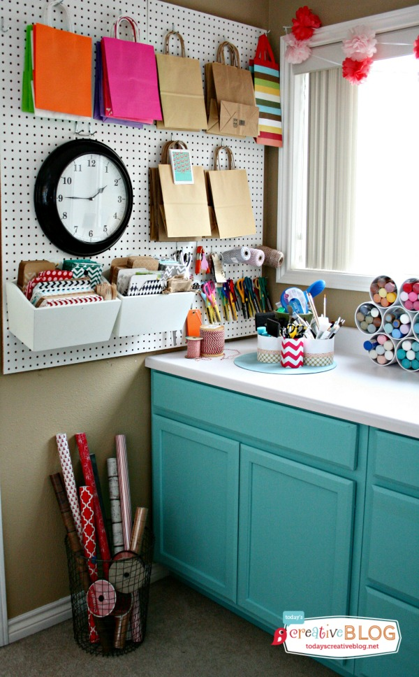 4. Craft Room Corner Wrapping Station. I love how this wrapping station fits perfectly into the corner of an entire craft room. The wire basket is a functional and beautiful solution to storing rolls of wrapping paper.