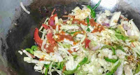 Ading chilly sauce, soya sauce with vegetables for chicken hakka noodles recipe