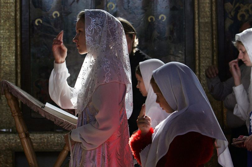 Old-Believers-pray-in-the-church-of-Our.jpg