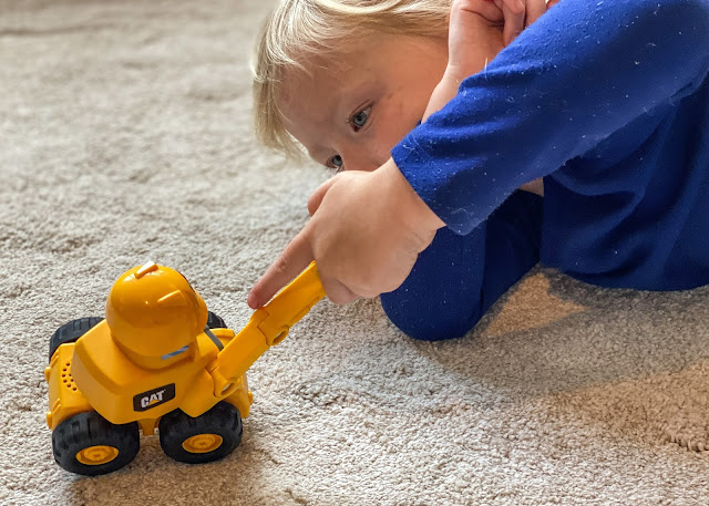 A 4 year old playing with the preschool construction pal toys