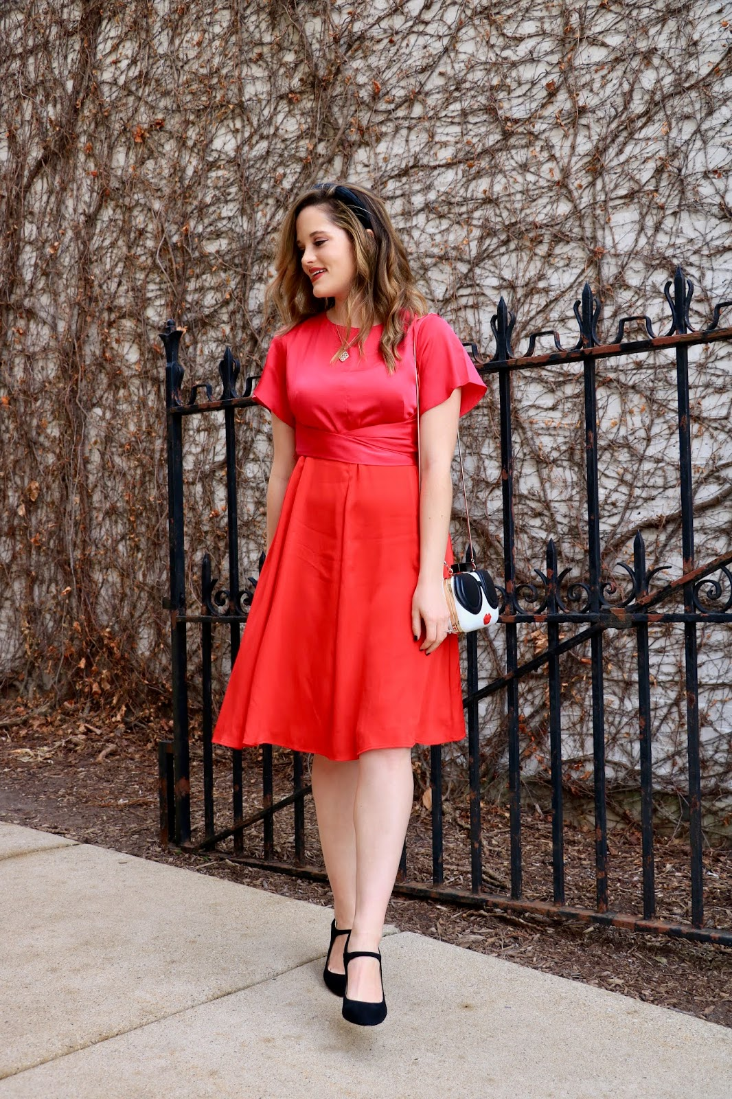 Nyc fashion blogger Kathleen Harper wearing a pink and red Valentine's Day outfit.