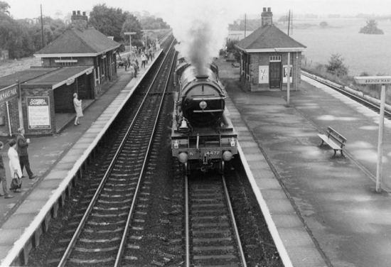Photograph of Sir Nigel Gresley's A3 locomotive No.4472 Flying Scotsman heading north through Brookmans Park Station on its last journey before leaving for the USA. Note the bell fitted to comply with American regulations. August 31, 1969