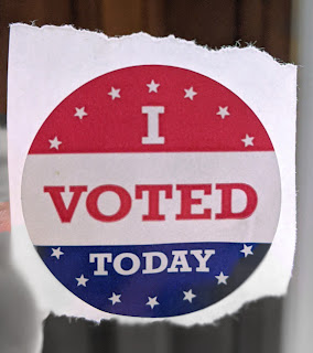 """A """"I voted today"""" sticker on white paper."""