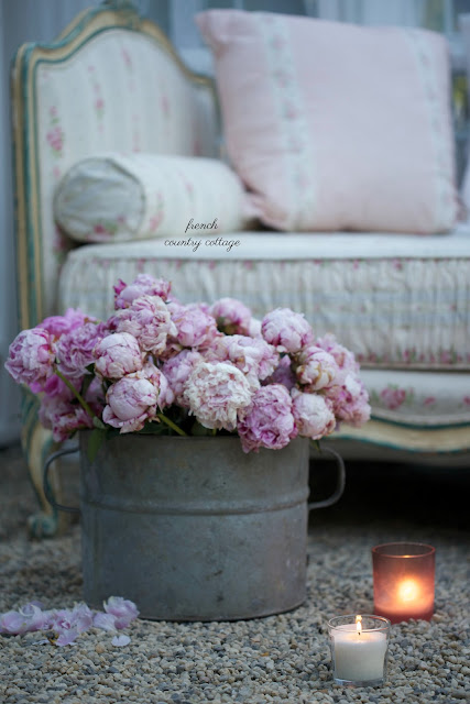 zinc bucket filled with flowers