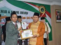 KH. Amiruddin Nahrawi Staf Ahli Gubernur Sumsel Raih Anugerah FKDMI Award 2019