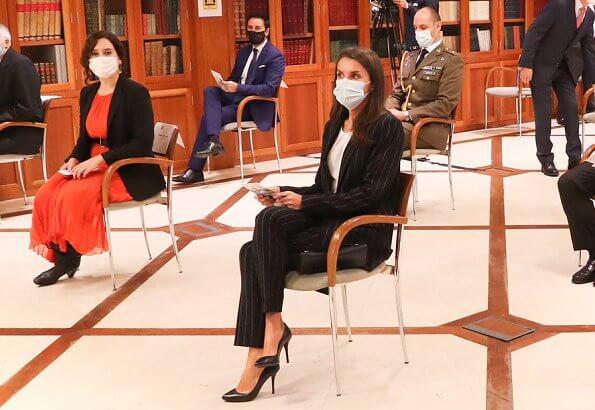 Queen Letizia wore a new striped suit blazer from Hugo Boss. Letizia wore Hugo Boss Kocani striped suit. Magrit pumps, Carolina Herrera clutch
