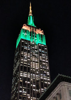Empire State building lit with green and white lights, New York, New York