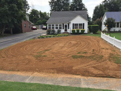 grading a yard,grading slope,how to grade a yard,grading yard,lawn grading,yard grading,how to regrade yard,regrading yard,do it yourself lawn grading,grading yard away from house