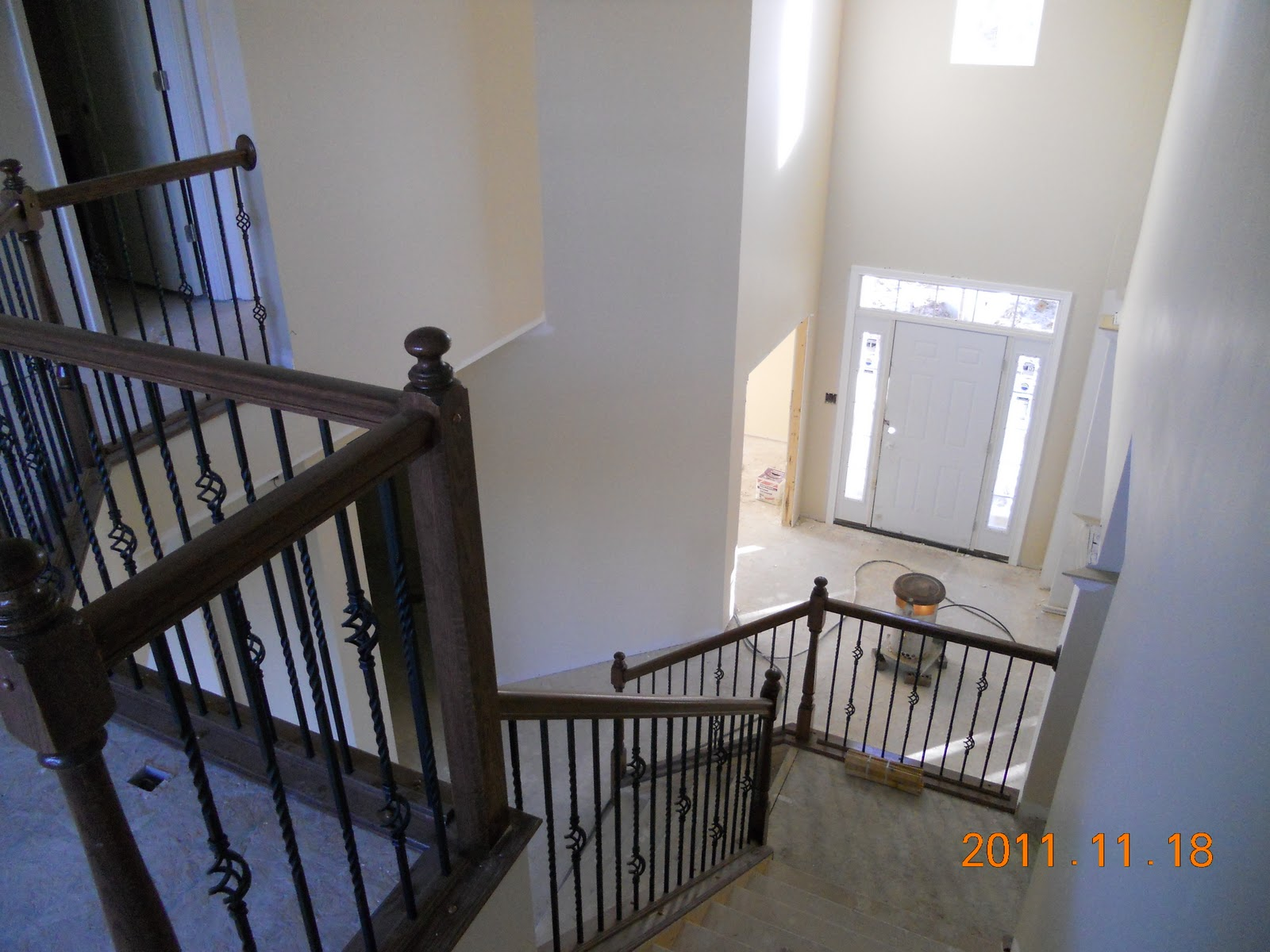 Basement Stair Trim: Brick Work Complete, Stair Railing Installed And Trim Work