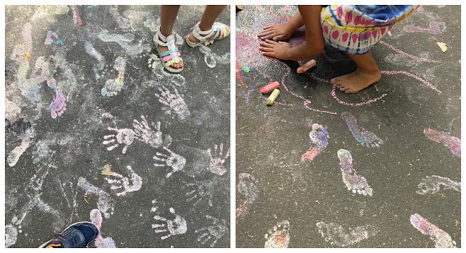 Hand- und Fußabdrücke auf Asphalt