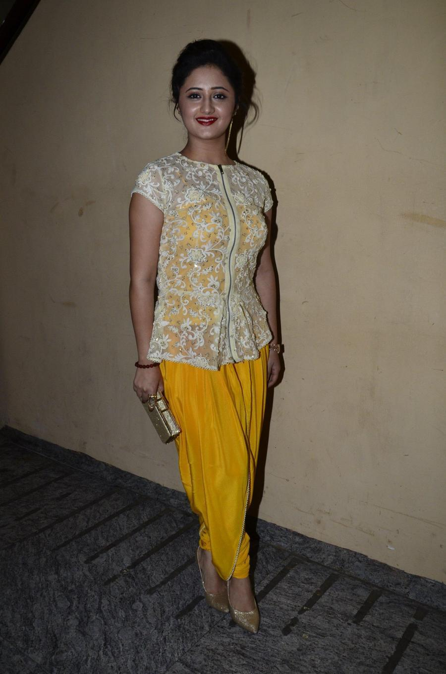 Hindi TV Actress Rashami Desai Smiling Stills In Yellow Dress