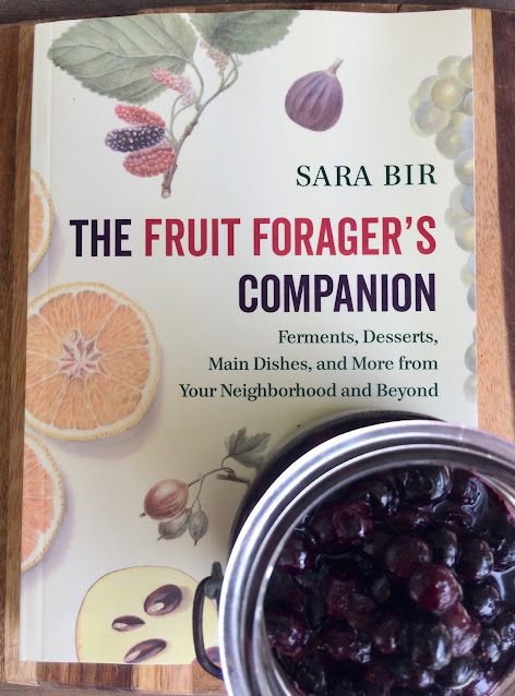 Fruit Foragers Companion book with a jar of Roasted Maple Blueberries.