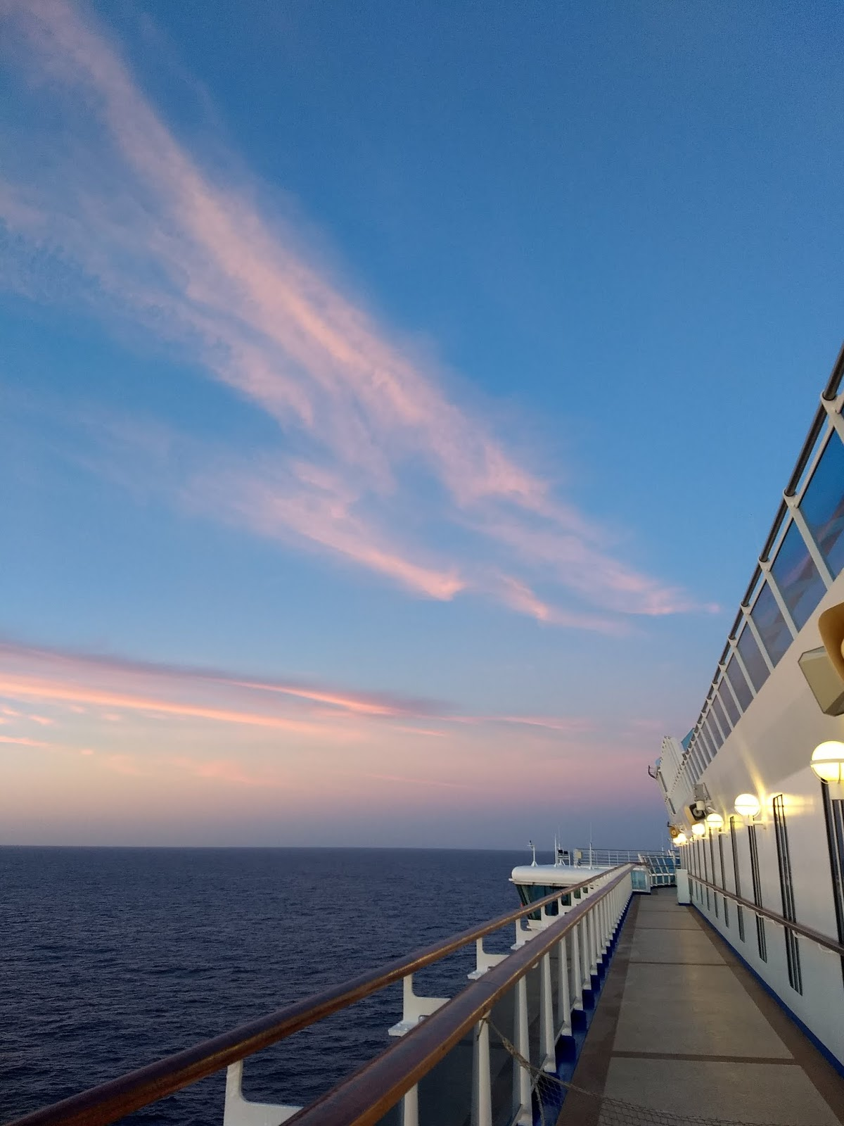 View of a sunrise sky from a cruise ship on the Atlantic Ocean.