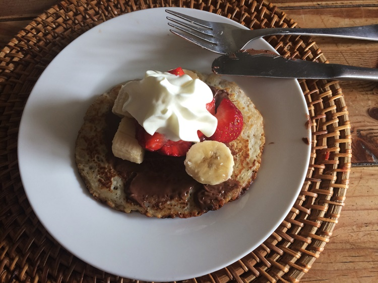 Oh yum - Pancakes with nutella, strwberries, banana and cream!