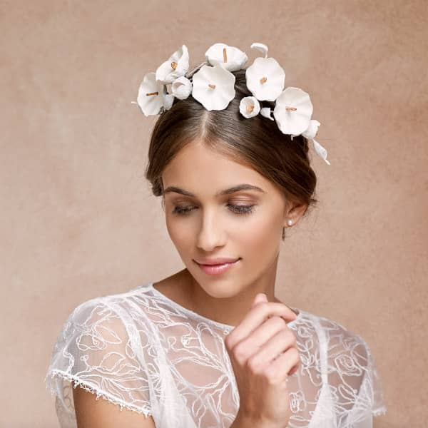 bride wearing white paper flower crown