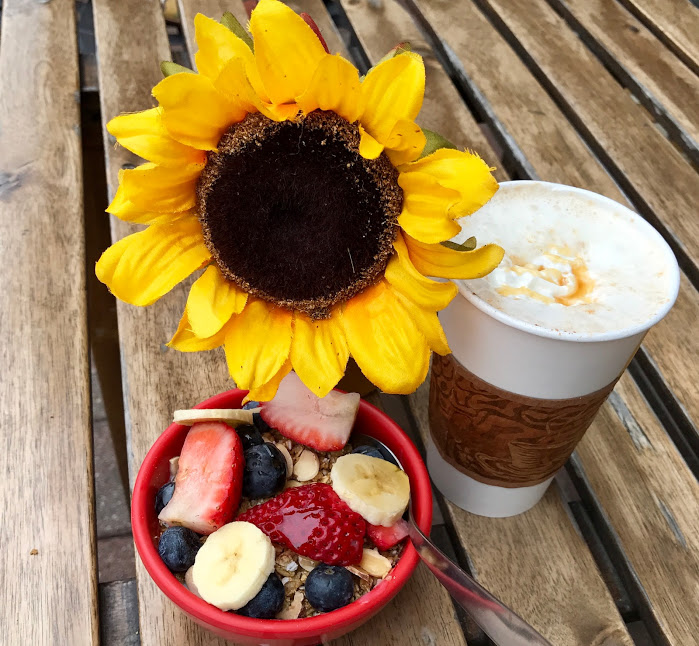 Oatmeal topped with strawberries, granola, bananas, blueberries and honey. Served with a caramel  coffee drinks