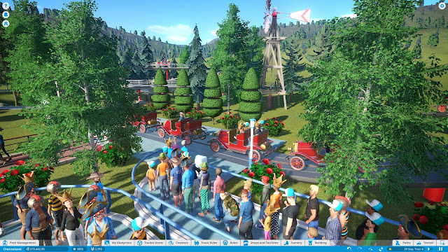 Screenshot of an antique car ride in Planet Coaster