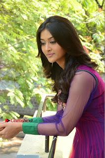 Actress Pooja Jhaveri Latest Stills in Purple Salwar Kameezt at Dwaraka Success Meet  0152.JPG