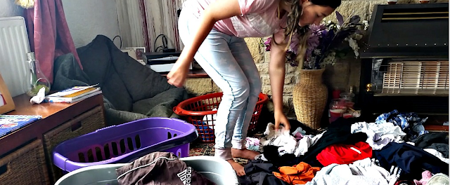 My youngest sorting out the washing.