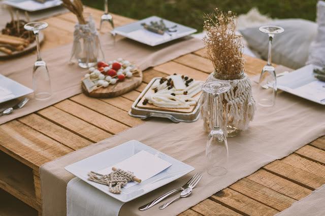 outdoor table laid:Photo by Ibrahim Boran on Unsplash