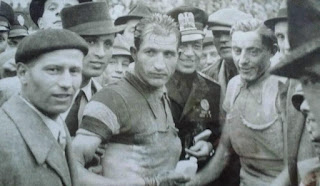 Coppi (right) with his great rival Gino Bartali (centre) at the  Giro d'Italia of 1940, which Coppi won in controversial fashion