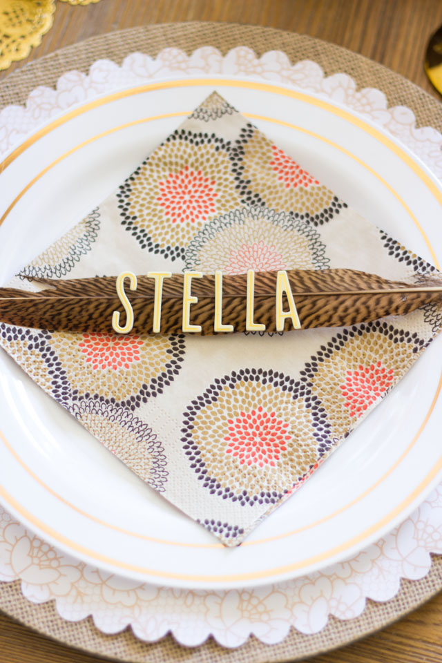 Create Thanksgiving place cards out of pheasant feathers and letter stickers - so easy!