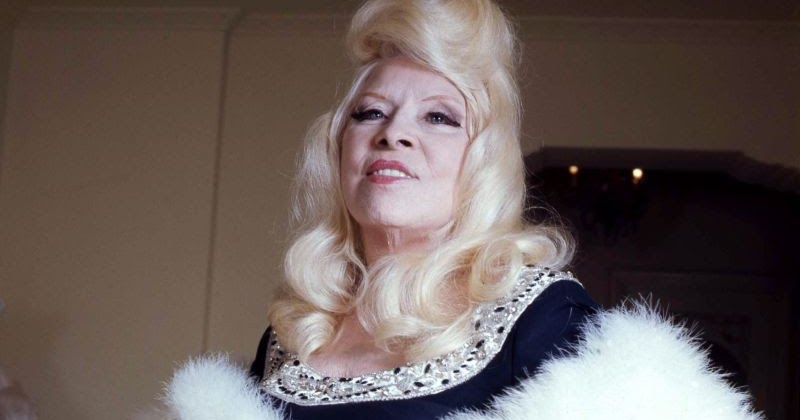 Pictures of Mae West in Her Living Room at Ravenswood, Los Angeles in 1973