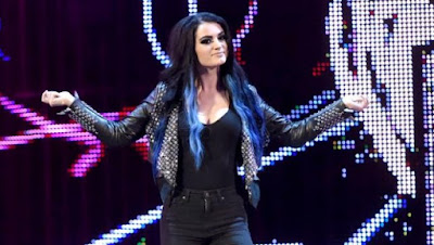 Paige shrugs on WWE
