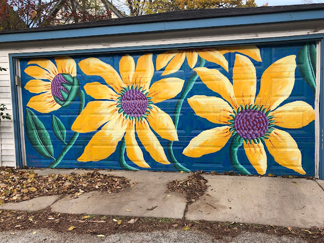 Bold sunflowers add cheer every day. Mural painted by artist Teresa Parod.