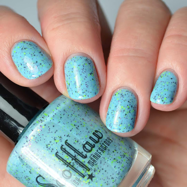 blue glitter nail polish four finger swatch