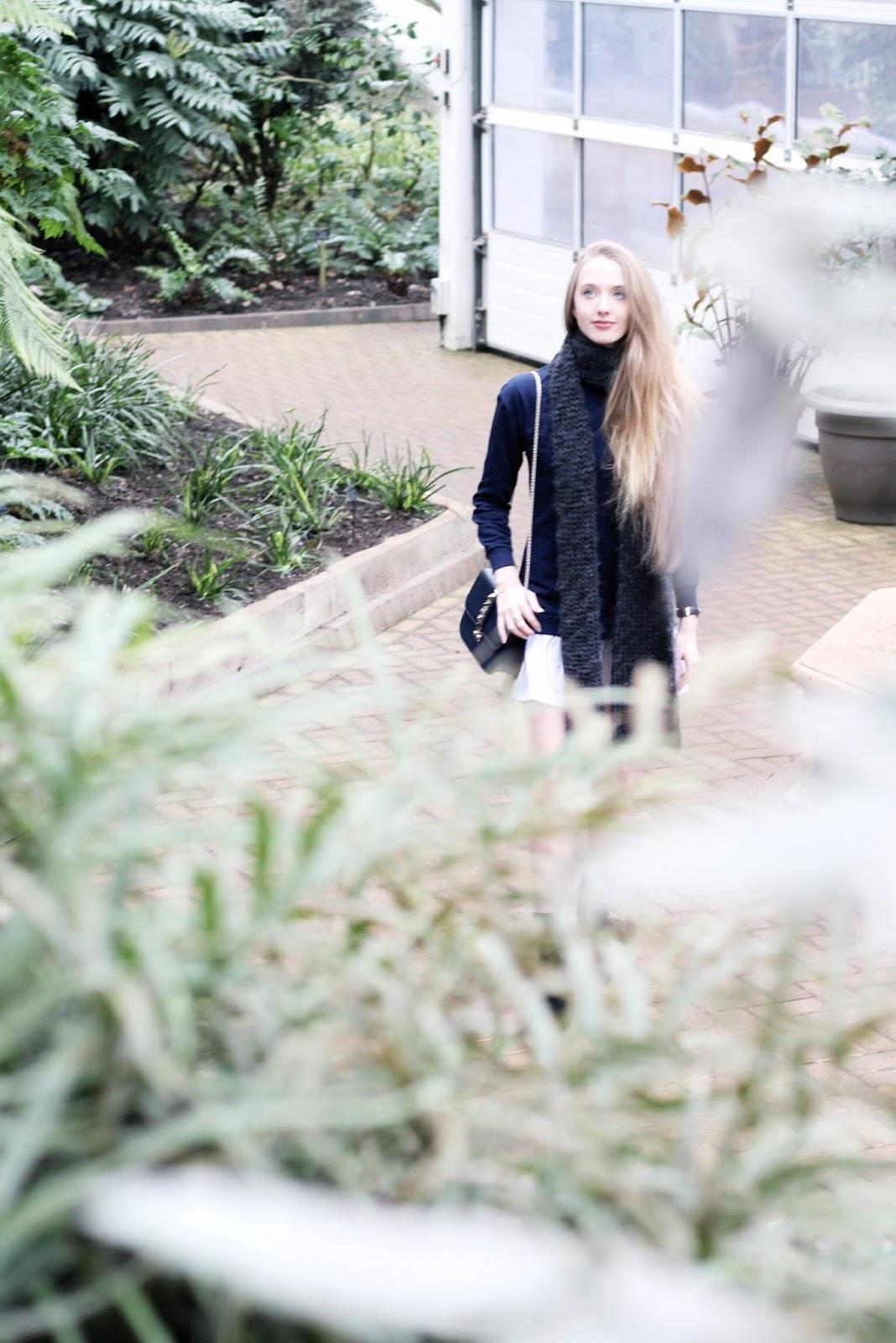 Blogger fashion shoot in bright white glasshouse