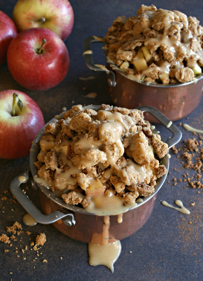 Recipe for an apple dessert baked in individual pots and covered with a peanut butter crumb topping and peanut butter sauce.