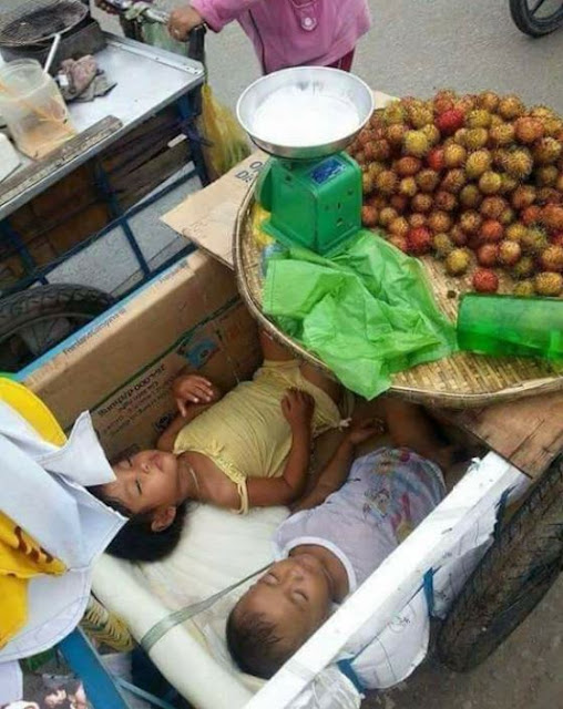 Dedicated Mom Sells Fruits On The Streets While Her Children Sleep On A Kariton
