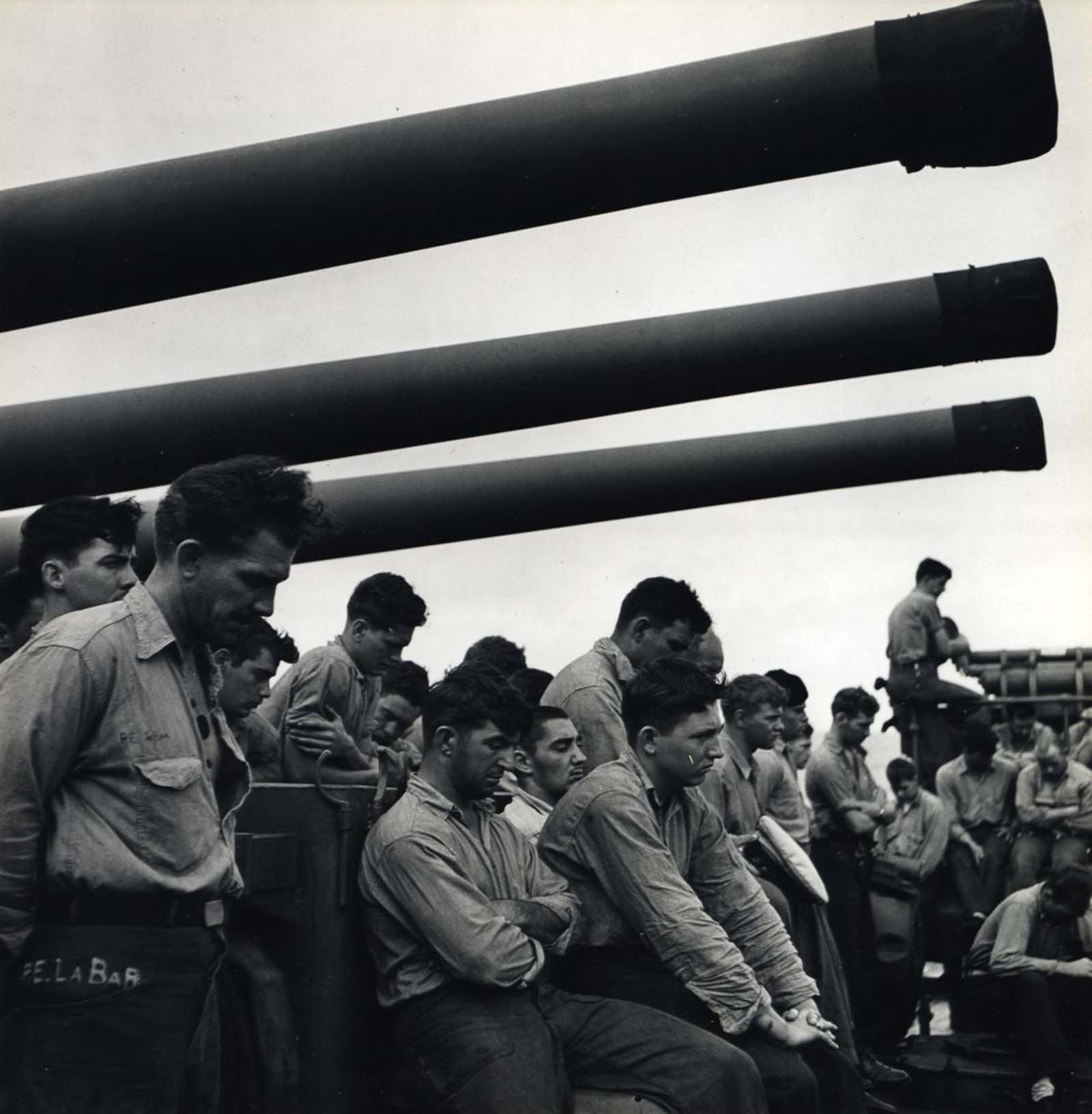 Sailors Aboard U.S.S. Yorktown with Naval Artillery Above, c. 1943.