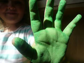 green painted child hands